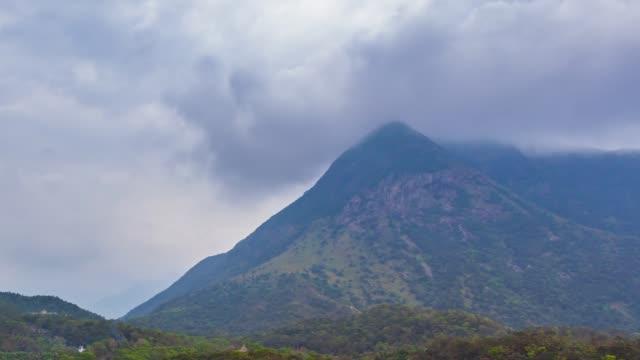 stockvideo's en b-roll-footage met misty over hoge berg bij ngong ping village, hong kong - hong kong