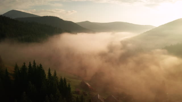 misty sunrise in the mountains with a beautiful sky. drone video - slovenia meadow stock videos & royalty-free footage