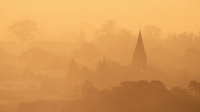 misty sunrise over village church, worcestershire, england - england stock videos & royalty-free footage