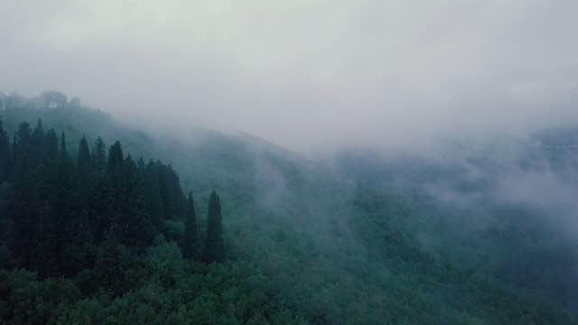 misty tuscany seen from above. cloudscape - overcast stock videos & royalty-free footage
