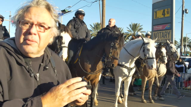 Mitch Landrieu mayor of New Orleans sits on a New Orleans Police Department horse while the Zulu Social Aid Pleasure Club gather at the intersection...