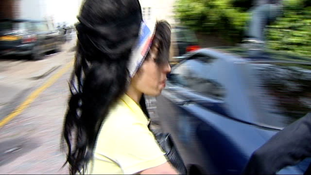 mitch winehouse interview on birthday of amy winehouse; r25040802 camden town: ext amy winehouse along from her house with unidentified woman through... - amy winehouse stock-videos und b-roll-filmmaterial