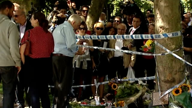 Mitch Winehouse interview on birthday of Amy Winehouse TX 2572011 / Audio = ITN ITV News EXT Mitch Winehouse looking at floral tributes outside home...