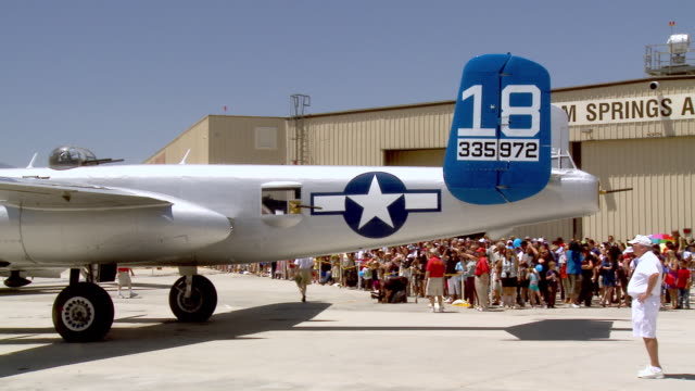 ws pan b25 mitchel bomber pulling tarmac during memorial day air show celebration  / palm springs, california , united states - bomber plane stock videos and b-roll footage
