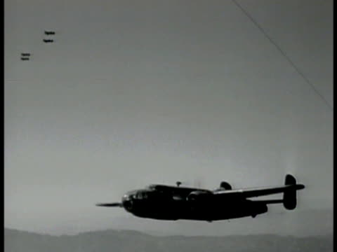 b25 'mitchell' bomber w/ four escort fighters above td mountains below w/ airplane prop spinning fg int bomber behind pilot copilot talking wwii... - b rolle stock-videos und b-roll-filmmaterial