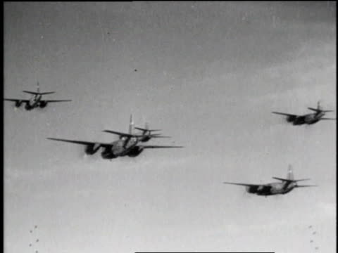 stockvideo's en b-roll-footage met mitchell bombers flying in fomration / pilot in cockpit of airplane / bombs exploding on ground / fighter planes flying / soldier talking on radio /... - kleine groep dingen