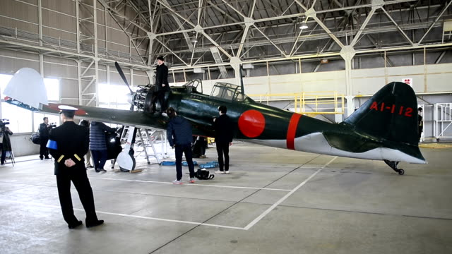 """A Mitsubishi A6M Zero World War II airplane made its """"homecoming flight"""" in Japan four decades after it was found in Papua New Guinea then restored..."""
