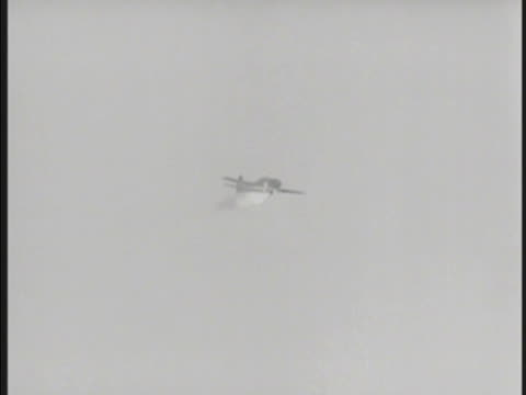 Mitsubishi A6M Zerosen 'Zero' 'Zeke' fighter aircraft in angled descent missing edge of US Carrier crashing in ocean water beyond warship w/ no...