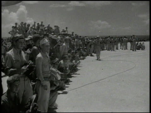 mitsubishi g4m 'betty' airplane landing at military base of ie jima united states soldiers looking on japanese emissaries deplaning meeting on... - japanese surrender stock videos and b-roll footage
