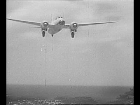 mitsubishi g4m bomber approaches as it reaches its destination of iejima it carries japanese delegates en route to manila for world war ii surrender... - japanese surrender stock videos and b-roll footage