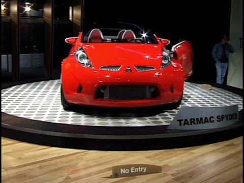 mitsubishi tarmac spyder revolving on turntable / dutch tilt of car revolving on turntable / front end of car / open driver side door; interior... - audio hardware stock videos & royalty-free footage