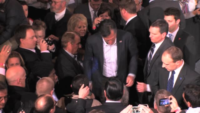 mitt romney getting glitterbombed by 20yearold peter lucas smith after a speech at the caucus watch party in denver colorado mitt romney glitter... - herbst stock videos & royalty-free footage