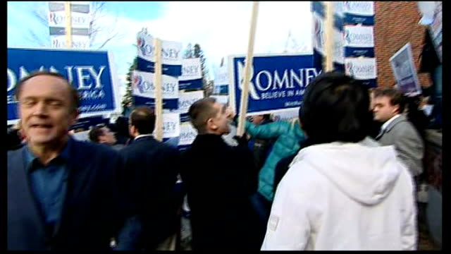 Mitt Romney hopes for backing of New Hampshire voters EXT Reporter to camera amid chanting Romney and Ron Paul supporters Romney greeting supporters...