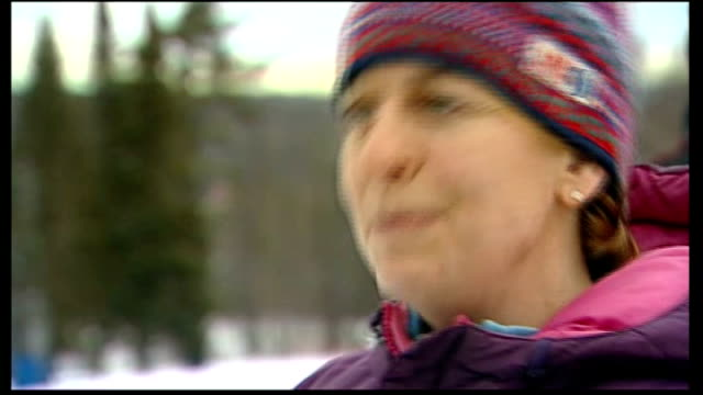 mitt romney hopes for backing of new hampshire voters new hampshire women's slalom race in progress spectator applauding skier crossing finish line... - slalom skiing stock videos & royalty-free footage