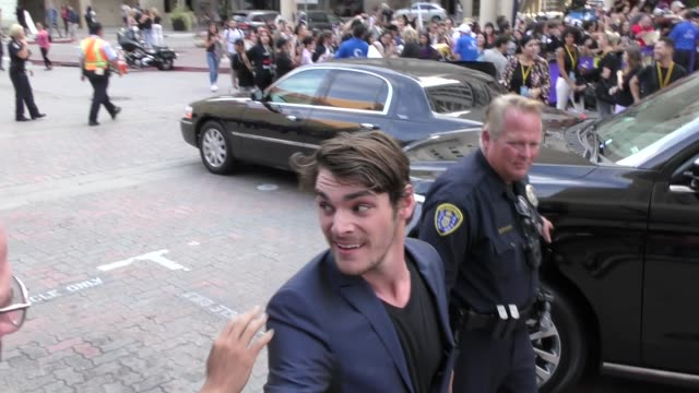 RJ Mitte greets fans on Day 1 of 2018 ComicCon in San Diego in Celebrity Sightings at ComicCon San Diego