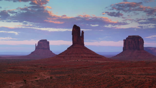 mitten buttes, monument valley - drone shot with upwards tilt - navajo reservation stock videos and b-roll footage