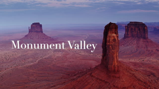 "mitten buttes with floating text: ""monument valley"" - drone shot - navajo reservation stock videos and b-roll footage"