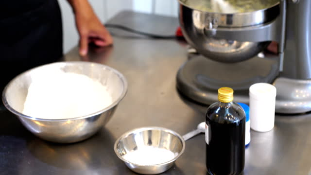 mix cake ingredients - making a cake stock videos and b-roll footage