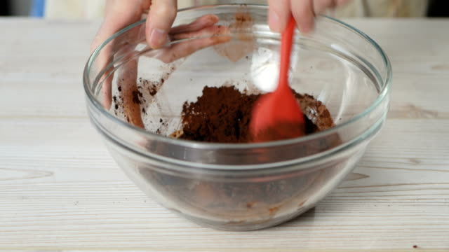 mix cocoa powder with hot water - mixing bowl stock videos and b-roll footage
