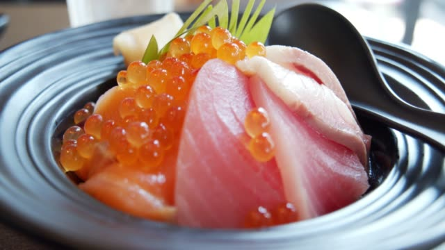 mix fish sashimi don with rice.japanese food style, healthy food concept - donburi stock videos and b-roll footage