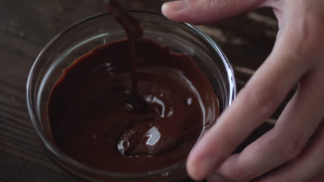 mix in the chocolate. - home made stock videos & royalty-free footage
