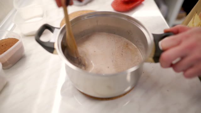 mix it until it becomes a chocolate milk - chocolate milk stock videos & royalty-free footage