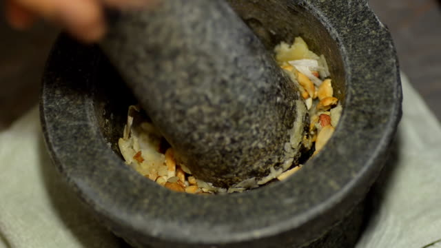mix peanut and garlic - mortar and pestle stock videos and b-roll footage