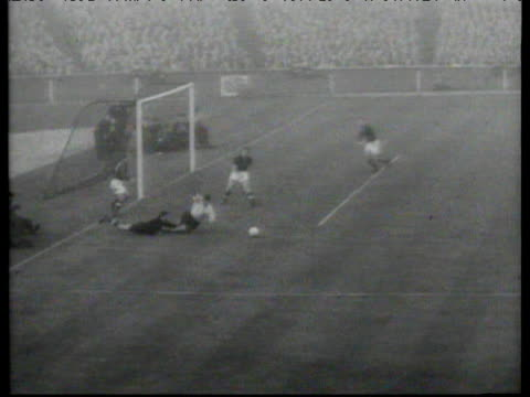 vídeos de stock, filmes e b-roll de mix up in hungarian defence leads gyula grosics to concede penalty which alf ramsay converts to make it 36 england vs hungary international friendly... - cultura húngara