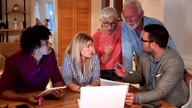 mixed age business group working together as one - employee engagement stock videos & royalty-free footage