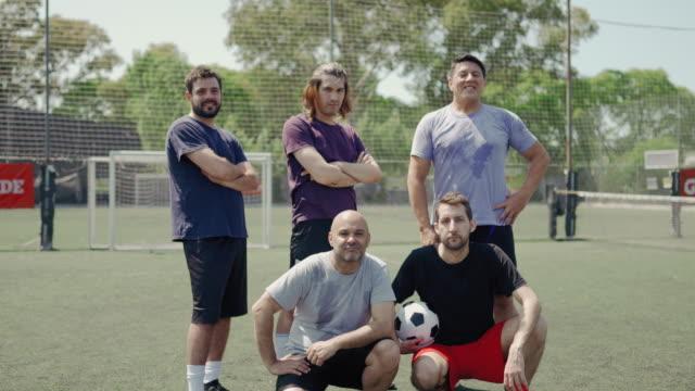 mixed age range men soccer team - mixed age range stock videos & royalty-free footage