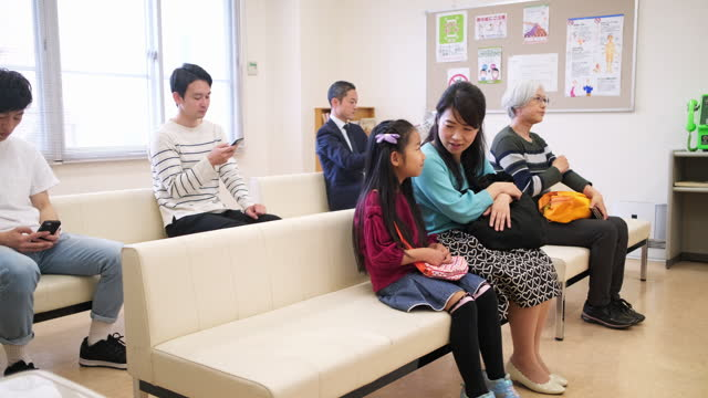 mixed age range of japanese patients in waiting room - mixed age range stock videos & royalty-free footage