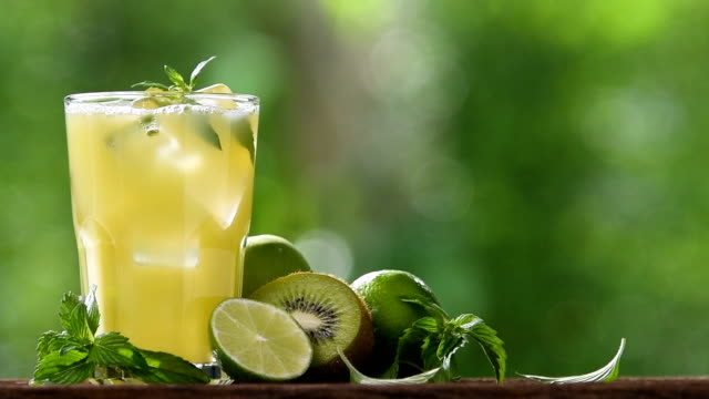 mixed apple,kiwi and lime juice pouring into glass - freshness stock videos & royalty-free footage