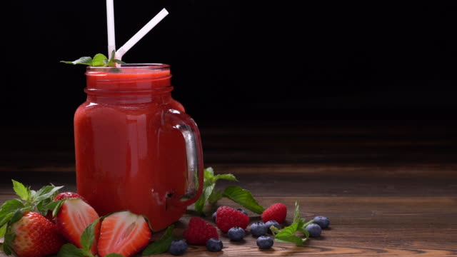 mixed berry smoothie in glass - smoothie stock videos and b-roll footage