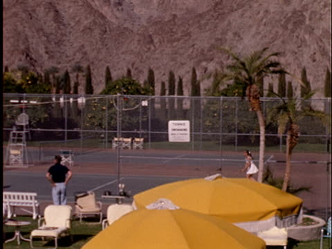 1965 ha ws pan mixed doubles tennis match at country club with mountains in background/ california - clubhouse stock videos & royalty-free footage