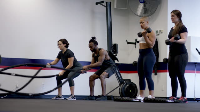 A mixed ethnic group fitness class doing a workout together