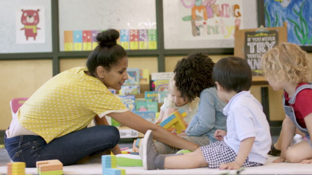 mixed ethnic preschool students in daycare - child care stock videos & royalty-free footage