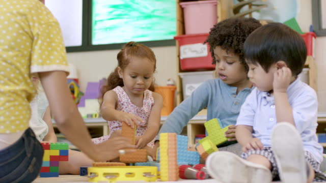 mixed ethnic preschool students in daycare - preschool child stock videos & royalty-free footage