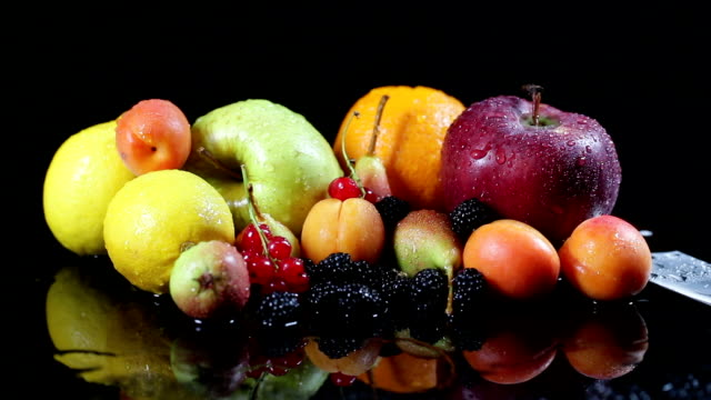 slo mo mixed fruit on wet surface with kitchen knife - fruit salad stock videos & royalty-free footage