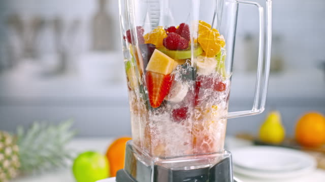 slo mo mixed fruit smoothie being blended in the jar - smoothie stock videos & royalty-free footage