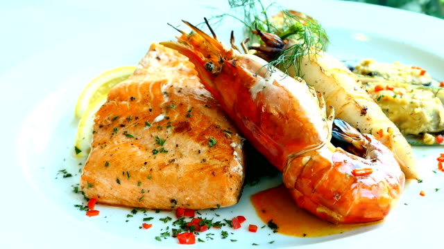 Mixed grilled seafood steak with salmon prawn and other meat