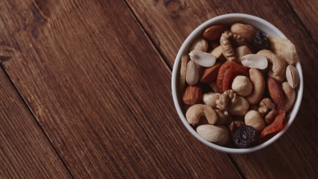 mixed nuts and dried fruits - bowl stock videos & royalty-free footage