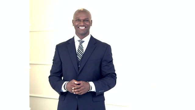 Mixed race black and Hispanic businessman in suit
