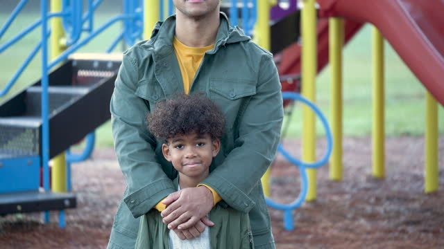 mixed race boy on playground with father - 8 9 years stock videos & royalty-free footage