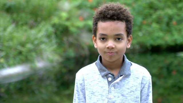mixed race boy outdoors at park - one boy only stock videos & royalty-free footage