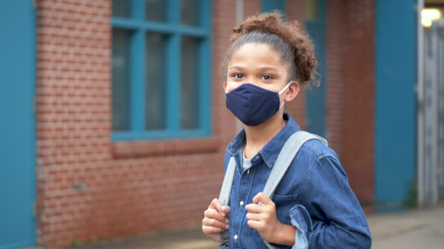 mixed race boy outside elementary school wearing mask - hair back stock videos & royalty-free footage