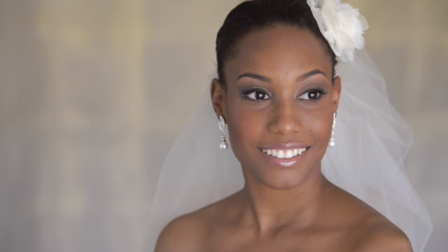 Mixed race bride smiling