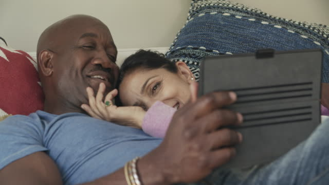 cu mixed race couple relaxing at home - real wife sharing stock videos and b-roll footage