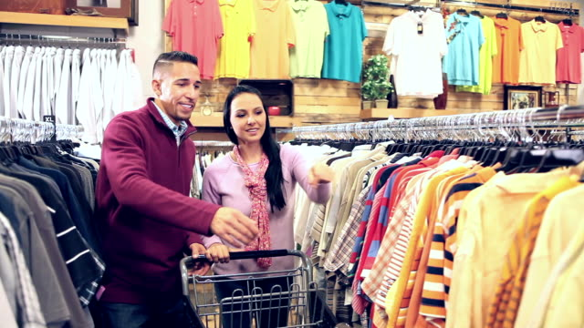Mixed race couple shopping in clothing store