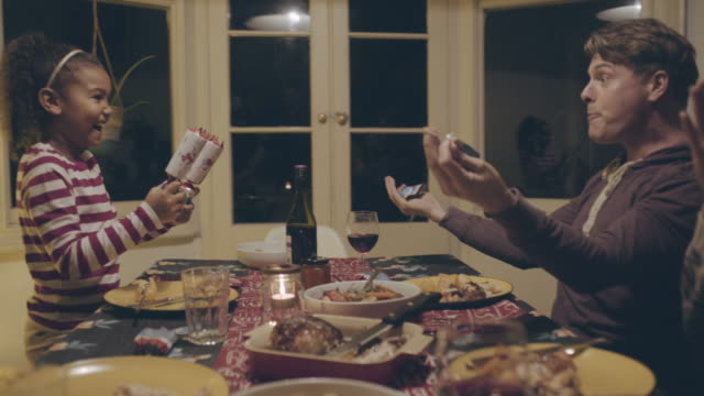 mixed race family opening christmas crackers - cracker stock videos and b-roll footage