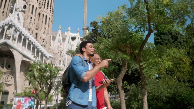 mixed race father and son enjoying city break in barcelona - city break stock videos & royalty-free footage